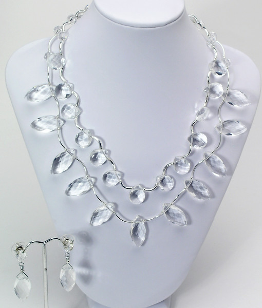 "#16915<br>Two strand of clear crystal <br>With silver plated tubes,<br>Clasp and 4"" extender chain. <br>17"" to 21"" One-of-a-kind.<br>Necklace $150.00<br>Earrings with crystal and sterling posts $29.00"