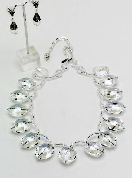 "#16613 <br>Clear crystal biolettes with silver plated clasp<br> and 4"" extender chain.<br> Alice Bailey Designs signature tag. <br> 16"" to 20"" Limited Edition.<br> Necklace $125.00  <br>Earrings with sterling silver filigree cones $48.00."