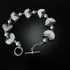 BRDC B1015WPO Seven petal bracelet with opposing finish and white pearls.