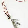 "#10919<br>Pewter feathers and ball<br>On red leather and pewter.<br>30.5"" Limited Edition. <br>Necklace $55.00"