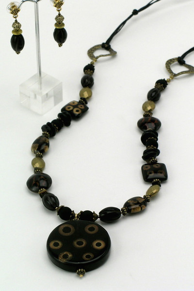 "#11312 <br>Bamboo eye focal with coconut twig, black turquoise, <br>antiqued bronze and rubber. <br> Black cotton cording at back.<br>Necklace  32"" Limited Edition $95.00<br>Earrings with bronze and surgical steel posts $35.00"