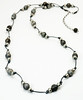 "#16118<br>Gunmetal stardust and pewter on metallic silver leather.<br>Gunmetal clasp and 4"" extender chain.<br>36"" to 40"" or doubled at 19"" Limited Edition.<br> Shown long.<br>Necklace $85.00"