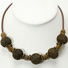 "#10120<br>Bronze mesh and <br>Antiqued bronze beads on rubber. <br>Antiqued bronze clasp <br>And 4"" extender chain. <br>16"" to 20"" Limited Edition.<br>$55.00"