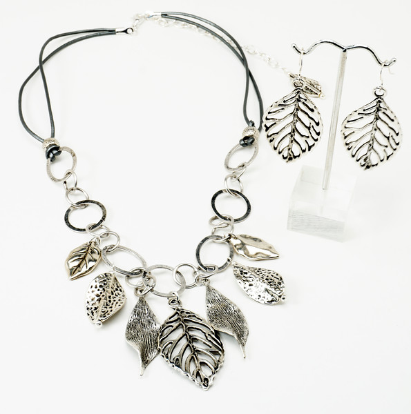 """#12317 <br>Pewter leaves on silver plated chain and metallic silver leather. <br>Silver plated clasp and 4"""" extender chain. <br>Necklace 21"""" to 24.5"""" Limited Edition $59.00<br>Earrings with silver ear wires $25.00"""