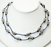 "#16218<br>Pewter on metallic blue leather.<br>Silver plated clasp and 4"" extender chain.<br>38"" to 42"" or doubled at 19+"" Limited Edition.<br> Shown doubled.<br>Necklace $85.00"