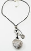 "#11417 <br>Pounded pewter heart and key on black leather. <br>Silver plated clasp and 4"" extender chain.<br> 19"" to 23"" Limited Edition $49.00"