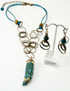 "#12117 <br>Turquoise and brass mosaic horn <br>on multi-loop antiqued bronze chain and teal leather. <br>Antiqued bronze clasp and 4"" extender chain. <br>Necklace 21"" to 25"" Limited Edition $65.00<br>Earrings with antiqued bronze French clips $35.00"