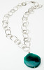 "#11317 <br>Faceted green agate disc on <br>silver plated chain and pewter clasp.<br>30"" or less. <br>Limited Edition $55.00"