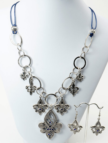 "#12017A Pewter Fleur de Lis and cobalt blue Swarovski crystal drops on silver plated chain and metallic blue leather. <br>Silver plated clasp and 4"" extender chain. <br>19"" to 23"" Limited Edition.<br><br><a href=""https://www.paypal.com/cgi-bin/webscr?cmd=_cart&add=1&business=alice@AliceBaileyDesigns.com&item_name=Alice%20Bailey%20Designs%20Item%20Number%2012017A%20Necklace&item_number=12017A&amount=%2449.00&return=http://www.paypal.com&cancel_return=http://www.paypal.com"" target=""_click"" class=""paypalbutton"">Purchase Necklace $49.00</a><br><br> <br><br><a href=""https://www.paypal.com/cgi-bin/webscr?cmd=_cart&add=1&business=alice@AliceBaileyDesigns.com&item_name=Alice%20Bailey%20Designs%20Item%20Number%2012017A%20Earrings&item_number=12017A&amount=%2417.00&return=http://www.paypal.com&cancel_return=http://www.paypal.com"" target=""_click"" class=""paypalbutton"">Purchase Earrings $17.00</a><br><br> <br><br><a href=""https://www.paypal.com/cgi-bin/webscr?cmd=_cart&add=1&business=alice@AliceBaileyDesigns.com&item_name=Alice%20Bailey%20Designs%20Item%20Number%2012017A%20Earrings%20and%20Necklace&item_number=12017A&amount=%2466.00&return=http://www.paypal.com&cancel_return=http://www.paypal.com"" target=""_click"" class=""paypalbutton"">Purchase Necklace and  Earrings $66.00</a><br><br> <br><br><br><br><img src=""http://ali.smugmug.com/Other/WebSiteImages/i-BftLFq2/0/O/paypal-175-50-O.jpg""><br><font class=""captionfooter"">Free Shipment on all Orders</font>"