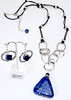 "#22116 <br>Lapis drop on antiqued silver chain,<br> pewter and blue/black leather. <br>Antiqued silver clap and 4"" extender chain. <br>Necklace 30"" to 34"" Limited Edition $115.00<br>Earrings with silver plated French clips $28.00"