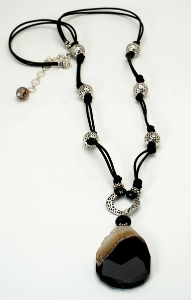 "#12018<br>Dream agate and black onyx <br>On pewter and black leather. <br>Silver plated clasp and 4"" extender chain.<br>32"" to 36"" Limited Edition. <br>Necklace $99.00"