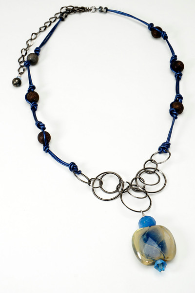 "#16716 One-of-a-kind art glass, chalcedony and crystal drop on gunmetal chain, stardust beads and dark blue leather. Gunmetal clasp and 4"" extender chain. 21"" to 25"" <br><br><a href=""https://www.paypal.com/cgi-bin/webscr?cmd=_cart&add=1&business=alice@AliceBaileyDesigns.com&item_name=Alice%20Bailey%20Designs%20Item%20Number%2016716%20Necklace&item_number=16716&amount=%24125.00&return=http://www.paypal.com&cancel_return=http://www.paypal.com"" target=""_click"" class=""paypalbutton"">Purchase Necklace $125.00</a><br><br>"