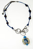 "#16716 One-of-a-kind art glass, chalcedony and crystal drop on gunmetal chain, stardust beads and dark blue leather. Gunmetal clasp and 4"" extender chain. 21"" to 25"" <br><br><a href=""https://www.paypal.com/cgi-bin/webscr?cmd=_cart&amp;add=1&amp;business=alice@AliceBaileyDesigns.com&amp;item_name=Alice%20Bailey%20Designs%20Item%20Number%2016716%20Necklace&amp;item_number=16716&amp;amount=%24125.00&amp;return=http://www.paypal.com&amp;cancel_return=http://www.paypal.com"" target=""_click"" class=""paypalbutton"">Purchase Necklace $125.00</a><br><br>"
