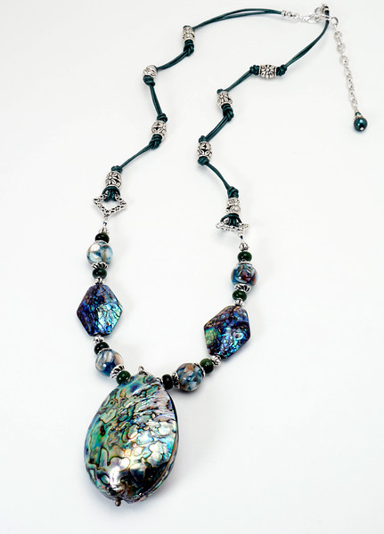 "#11918<br>Abalone shell, shell mosaic, jade and pewter<br>On jade green leather.<br>Silver plated clasp and 4"" extender chain.<br>29"" to 33"" Limited Edition.<br>Necklace 150.00"