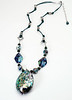 """#11918<br>Abalone shell, shell mosaic, jade and pewter<br>On jade green leather.<br>Silver plated clasp and 4"""" extender chain.<br>29"""" to 33"""" Limited Edition.<br>Necklace 150.00"""
