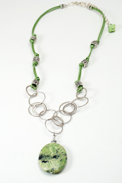 """#24316<br> Gaspeite on antiqued silver chain,<br> pewter and leather. <br>Silver plated clasp and 4"""" extender chain.<br>22"""" to 26"""" Limited Edition $95.00 <br>Note: natural stones will vary"""