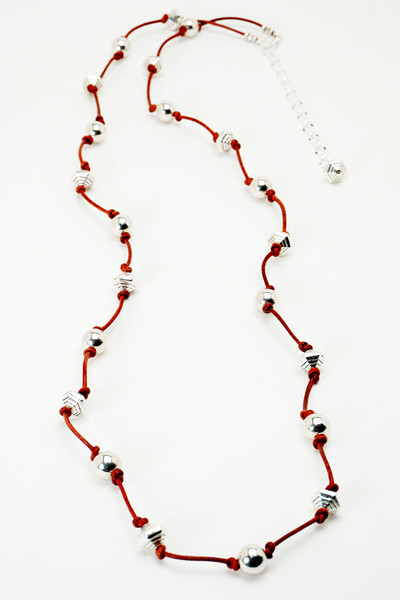 """#20019<br>Pewter and distressed red leather.<br>Silver plated clasp and 4"""" extender chain.<br> Wear long at 35"""" to 39"""" or doubled.<br>$85.00"""