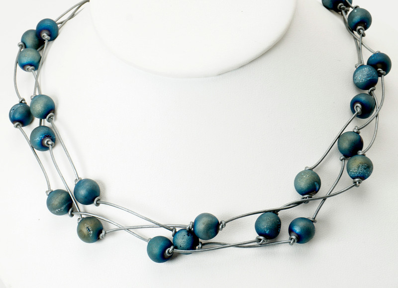 "#11619<br>Blue/aqua quartz druzy beads<br>On silver leather.<br>Silver plated clasp and 4"" extender chain.<br>$115.00"