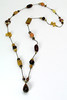 "#22913 <br>Brecciated jasper, Ironite, carved Bronzite, <br>agate, yellow jade and bronze on silk cord. <br>Granulated gold plated magnetic clasp. <br>Necklace 36"" or doubled at 18"" Limited Edition $125.00"