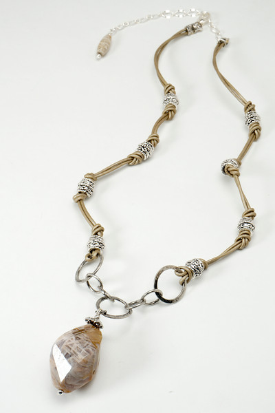 "#25416 <br>Spiral faceted crazy-lace agate<br> on silver plated chain, pewter and leather.<br>Silver plated clasp and 4"" extender chain. <br>20.5"" to 24.5"" Limited Edition $95.00 <br> Note: color in these natural stones will vary slightly."