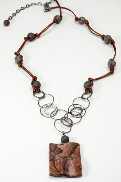 "#24416 <br>Chocolate agate on gunmetal chain, beads and leather. <br>Gunmetal clasp and 4"" extender chain. <br> 28"" to 32"" Limited Edition $95.00"