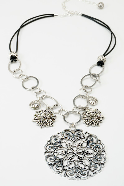 "#11817 <br>Pewter flowers on silver plated chain, black leather and pewter. <br>Silver plated clasp and 4"" extender chain. <br>20"" to 24"" Limited Edition $49.00"