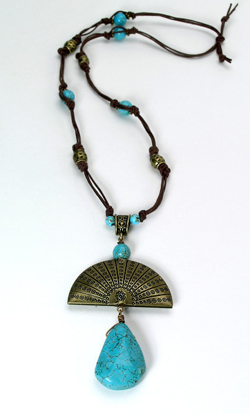 #21113 <br>Magnesite turquoise and antiqued bronze drop<br> on cotton cording with <br>magnesite turquoise and antiqued bronze. <br>Limited Edition $75.00