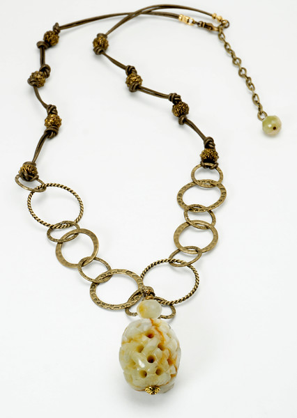 "#11818<br>Carved jade and antiqued bronze chain,<br> beads, clasp and 4"" extender chain.<br>30"" to 34"" Limited Edition.<br> Necklace $99.00"