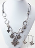 "#12017B <br>Pewter Fleur de Lis and amethyst Swarovski crystal drops <br>on silver plated chain and metallic silver leather. <br>Silver plated clasp and 4"" extender chain. <br>Necklace 19"" to 23"" Limited Edition $49.00<br>Earrings with surgical steel ear wires. $17.00"