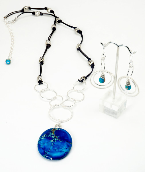 """#15718<br>Grade""""A"""" Imperial jasper drop<br>On pewter and black leather.<br>Silver plated clasp and 4"""" extender chain.<br>28"""" to 32"""" Limited Edition.<br>Necklace $95.00<br> Earrings with silver plated French clips $33.00"""