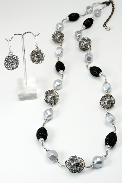 "#23716 <br>Gunmetal wire wrapped silver glass pearls, mesh, pewter.<br> Gunmetal tubes, clasp and 4"" extender chain. <br>Necklace 34"" to 36"" or doubled at 18"" Limited Edition $150.00<br>Earrings with silver plated French clips $27.00"
