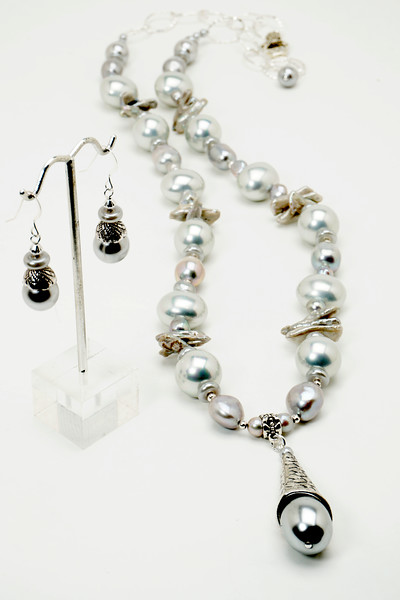 "#19718<br>Silver baroque, biwa and glass  pearls, <br>Pewter cone and clasp.<br>Silver plated chain.<br>34"" or less. Limited Edition.<br>Necklace $175.00<br>Earrings $27.00"