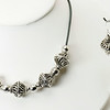 "#13419<br>Pewter swirl beads<br>On gray leather. <br>Silver plated clasp and 4"" extender chain.<br>16"" to 20"" Limited Edition.<br>Necklace $65.00<br>Earrings $30.00"