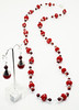 "#19918<br>Red velvet crystal, cranberry pearls<br>And silver plated tubes.<br>Silver magnetic clasp.<br>37"" or doubled at 18"" <br> Necklace $99.00<br>Earrings $28.00"