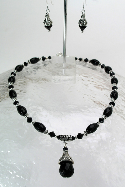 """#26313 <br>Faceted black onyx and pewter drop on black onyx and pewter.  <br>Silver plated clasp and 4"""" extender chain.<br> Alice Bailey Designs signature tag.<br>Necklace 16"""" to 20"""" Limited Edition $75.00<br>Earrings with sterling silver ear wires $26.00"""
