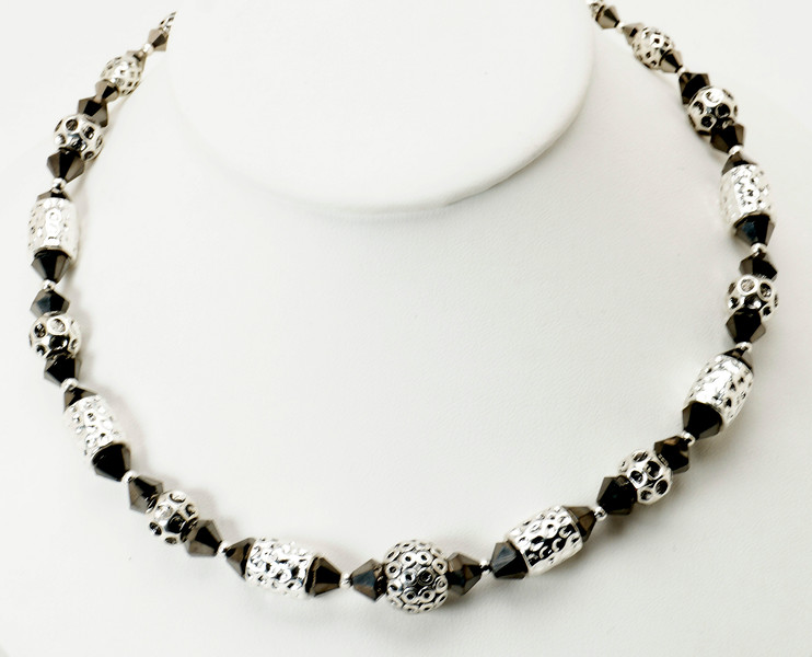 """#17119<br>Pounded pewter and crystal.<br>Silver plated clasp and 4"""" extender chain.<br>16"""" to 20"""" Limited Edition.<br>$69.00"""