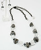 "#13617 <br>Silver electroplated quartz, hematite<br> and faceted natural quartz crystal. <br>Antiqued silver clasp and chain.<br> Necklace 30"" or less. Limited Edition $79.00<br>Earrings with gunmetal French clips $26.00"