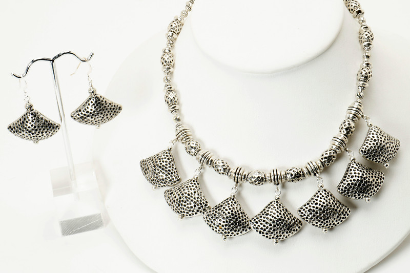 "#12119<br>Pounded pewter.<br>Silver plated clasp and 4"" extender chain.<br>16"" to 20"" Limited Edition.<br>$85.00<br>Earrings $27.00"