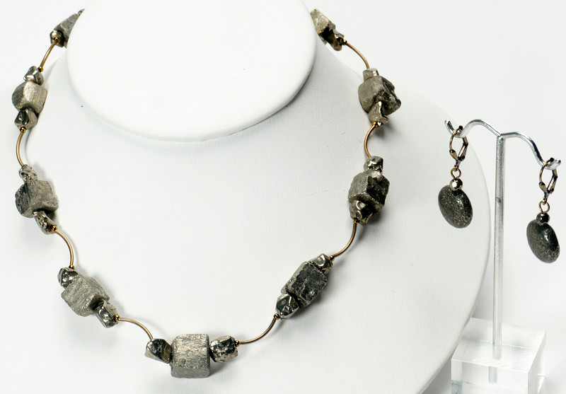 """#13320<br>Pyrite with antiqued bronze tubes.<br>Antiqued bronze clasp<br>And 4"""" extender chain.<br>17"""" to 21"""" Limited Edition.<br>Necklace 75.00<br>Earrings $29.00"""
