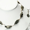"#13320<br>Pyrite with antiqued bronze tubes.<br>Antiqued bronze clasp<br>And 4"" extender chain.<br>17"" to 21"" Limited Edition.<br>Necklace 75.00<br>Earrings $29.00"