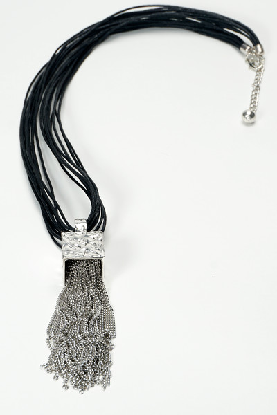 "#14920<br>Pewter fringed cube<br>On multi-cotton cord.<br>Silver plated clasp and extender chain.<br>36"" $75.00"