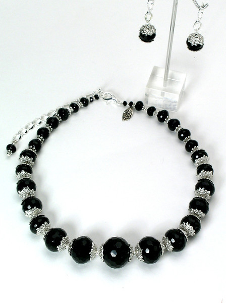 "#19113 <br>Graduated faceted black onyx and pewter. <br> Silver plated clasp and 4"" extender chain. <br> Alice Bailey Designs signature tag.<br>Necklace  22"" to 26"" Limited Edition $135.00<br>Earrings with silver plated French clips $26.00"