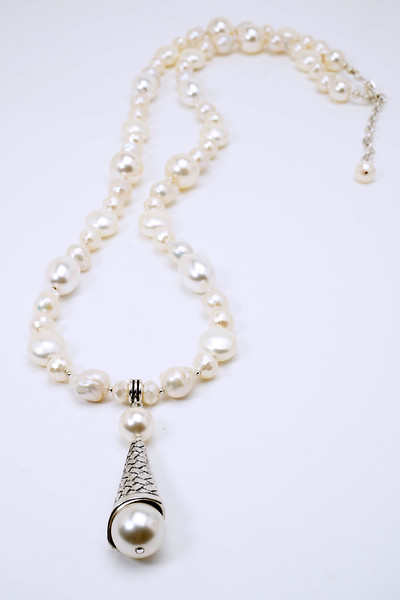 "#18318<br>Baroque pearls, Swarovski and shell pearls, <br>faceted glass pearls with pewter cone.<br> Silver plated clasp and 4"" extender chain.<br> 35"" to 39"" Limited Edition. <br>Necklace $195.00<br>Earrings $30.00"