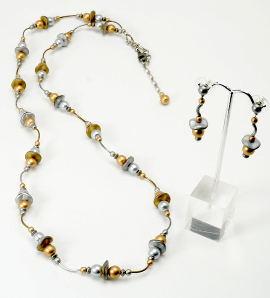 "#20117 <br>Matte silver and gold Czech glass, antiqued silver and bronze tubes. Antiqued silver clasp and 4"" built-in extender chain. 33"" to 37"" <br> OR doubled at 16.5"" to 18.5"" Limited Edition. <br>Necklace $99.00 Earrings with surgical steel post $28.00"