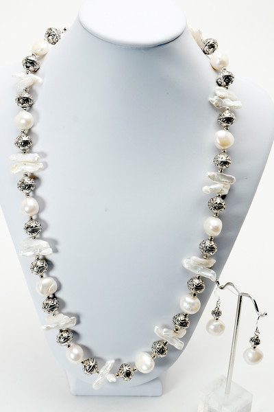 "#18817 <br>Natural white pearls and pewter. <br>Silver plated clasp and 5"" built-in extender chain.<br> Necklace 25"" to 29"" Limited Edition. $150.00<br>Earrings with silver ear wires $28.00"