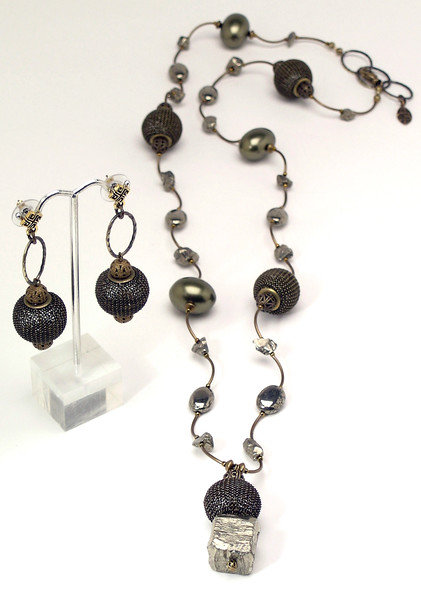 "#19315 <br>Pyrite and bronze mesh drop on pyrite, <br>bronze shell pearls, mesh and bronze tubes. <br>Antiqued bronze clasp and 2"" large extender chain. <br> Alice Bailey Designs signature tag. <br>Necklace 34"" to 36"" Limited Edition $125.00<br>Earrings with bronze and surgical steel posts $42.00"