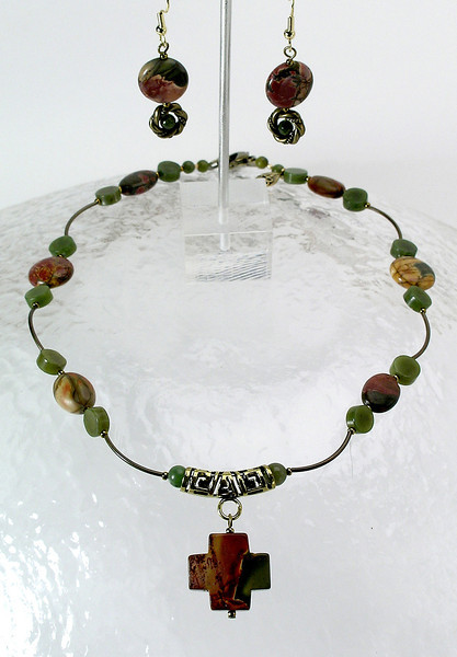 """#29212 <br>Imperial jasper cross on jade,<br> imperial jasper and antiqued bronze.<br> Bronze clasp and 4"""" extender chain. <br>Alice Bailey Designs signature tag.<br>Necklace16"""" to 20"""" Limited Edition $69.00<br>Earrings with gold plated ear wires $25.00"""