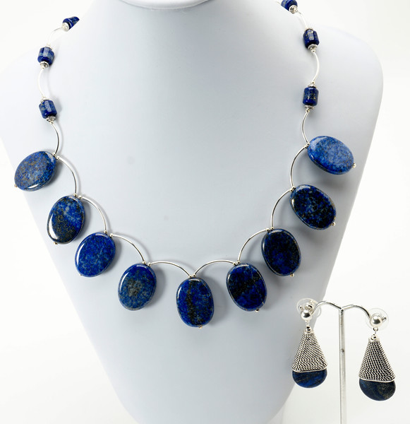 """#13319<br>Lapis and silver plated tubes.<br>Silver plated clasp and 4"""" extender chain.<br>17"""" to 21"""" Limited Edition.<br>Necklace $150.00<br>Earrings $29.00"""