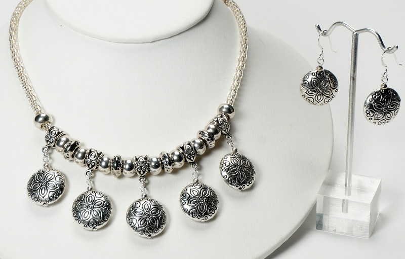 """#14420<br>Pewter on silver plated lantern chain.<br>Silver plated clasp and 4"""" extender chain.<br>16"""" to 20"""" Limited Edition.<br>Necklace $95.00<br>Earrings $26.00"""