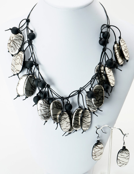 """#22719<br>Metallic acrylic, rubber and leather.<br>Nite black clasp<br>And 4"""" extender chain. <br>16"""" to 20"""" Limited Edition.<br>Necklace $150.00<br>Earrings $25.00"""